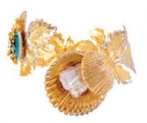 REMA LUXE Sea Shell Hand Cuff, PKR 10,500 www.remaluxe.com