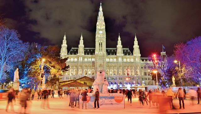 Ice Skating in front of Vienna City Hall (Christmas Time/ Holiday Celebrations) at Night in December - Vienna, Austria
