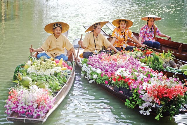 fruits and flowers floating in boats at RAMA IX Park